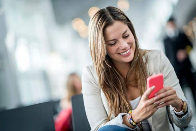 Image result for woman playing smartphone