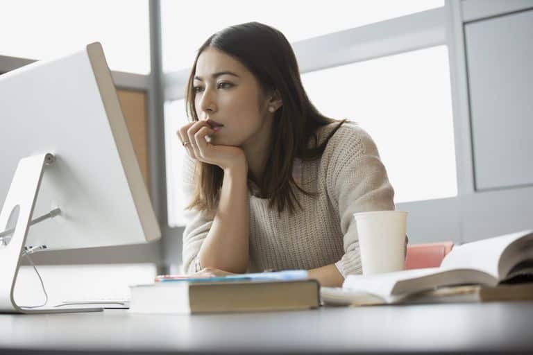 Image result for woman thinking alone at office