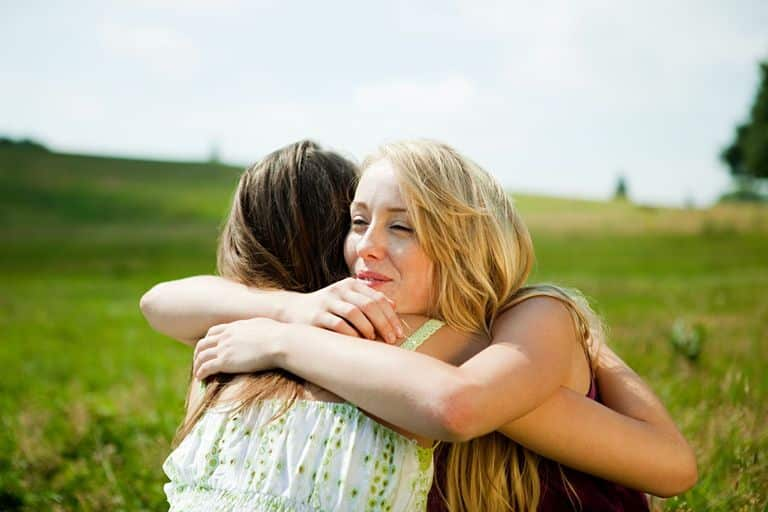 Image result for woman hugging friend
