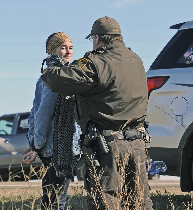 A Morton County Sheriff's deputy officer arrests actress Shailene Woodley at a protest against the Dakota Access Pipeline near St. Anthony, N.D., Monday, Oct. 10, 2016. The U.S. Army Corps of Engineers won't yet authorize construction of the $3.8 billion, four-state Dakota Access oil pipeline on federal land in southern North Dakota, it said Monday, along with reiterating its earlier request that the pipeline company voluntarily stop work on private land in the area. (Tom Stromme/The Bismarck Tribune via AP)