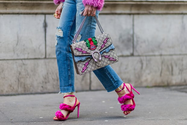 PARIS, FRANCE - March 07: Chiara Ferragni is wearing pink Marco De Vincenzo heel sandals, The Blonde Salad for Levi's ripped jeans, Gucci bag, pink Philosophy fur coat, vintage sunglasses outside Hermes during the Paris Fashion Week Womenswear Fall/Winter 2016/2017 on March 7, 2016 in Paris, France. (Photo by Christian Vierig/Getty Images)